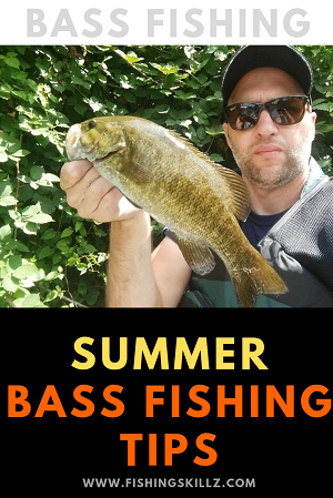 man holding smallmouth bass up by mouth